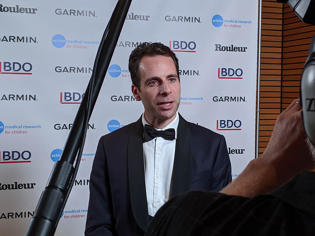 Mark Beaumont has his photo taken backstage at the 'Champions of Cyclesport' dinner.