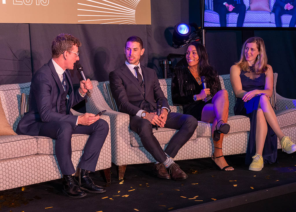 Gee Atherton, Shanaze Reade and Rachel Atherton chat to Matt Stephens on the sofa in front of guests at the 'Champions of Cyclesport' dinner.