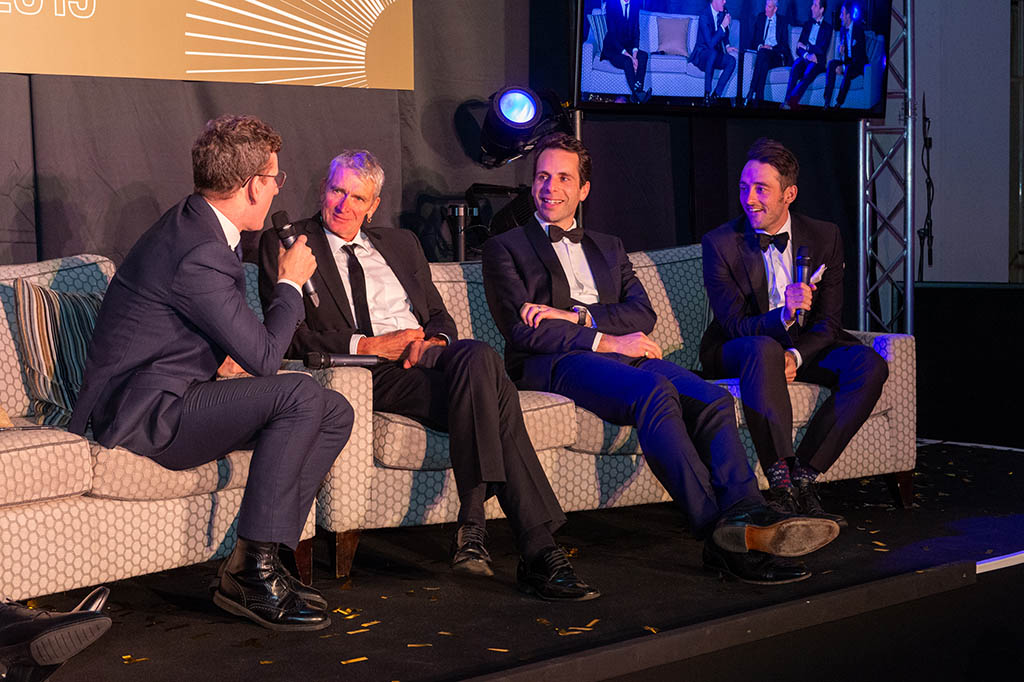 Sean Yates, Mark Beumont and Nathan Haas chat to Matt Stephens on the sofa in front of guests at the 'Champions of Cyclesport' dinner.