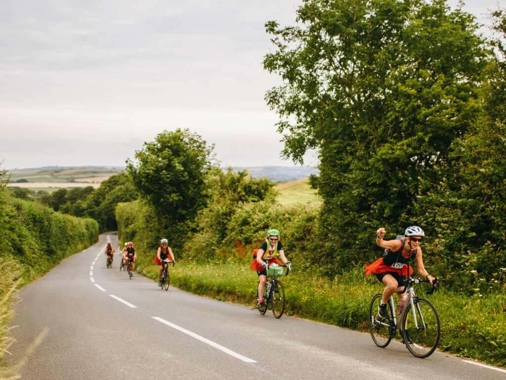 team of four cycling on quiet country lane