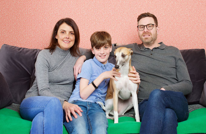 Finn with his mum, dad and dog