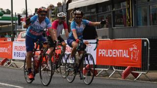 two cyclists riding side by side on ridelondon