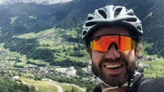 Close up of Anthony with backdrop of Swiss alps