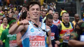 marathon runner pumping fist