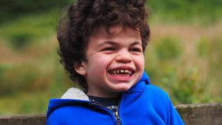 Smiling Danny who was diagnosed with Hunter Syndrome at 3 years old