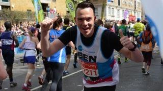 Marathon runner, Ben, with thumbs up and smiling