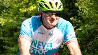 participant cycling on london to paris bike ride