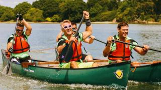 team of four canoeing