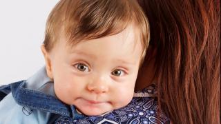 baby Jacob born prematurely aged one on mum's shoulder